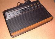Atari 2600 (Woody) with 2 joysticks/paddles and 4 games